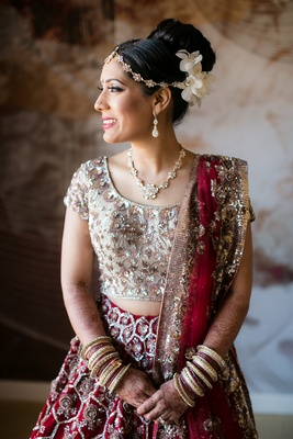 bride traditional red metallic ensemble sari indian hindu jewelry up do headpiece