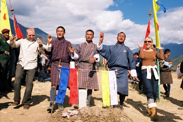 Bride and groom in street clothes with three Buddhist townspeople