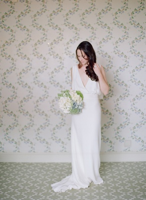 Bride wearing long wedding dress with deep v-neck
