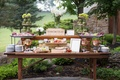 Wood table two tiers with vegetables, fruit, cheese, nuts, meat, and more