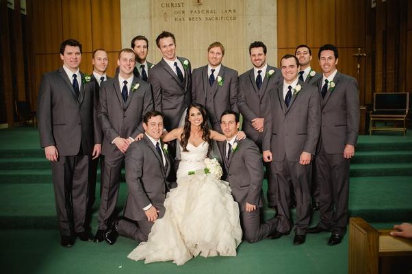 Men in grey three-piece tuxedos and dark ties
