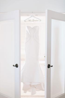 Wedding dress fluted bridal gown oscar de la renta wedding hanger french doors bridal suite