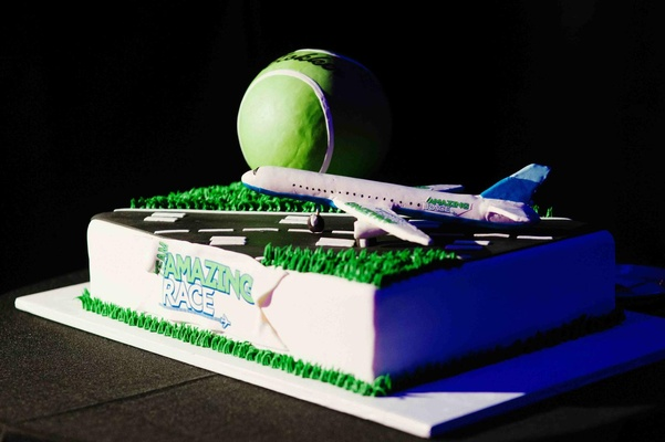 Cake Boss wedding cake with airplane runway and tennis ball