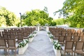 outdoor ceremony washington dc view of washington monument wood chairs flower boxes stone aisle