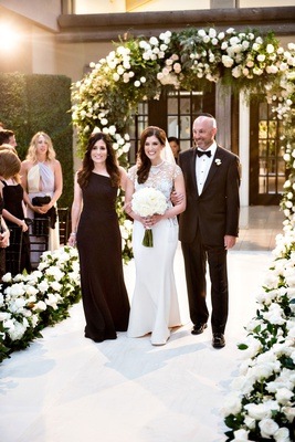 Wedding ceremony processional jewish wedding bride with father and mother of bride dad mom