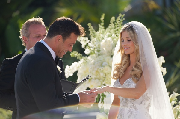 Romain Zago slides wedding ring onto Joanna Krupa's finger