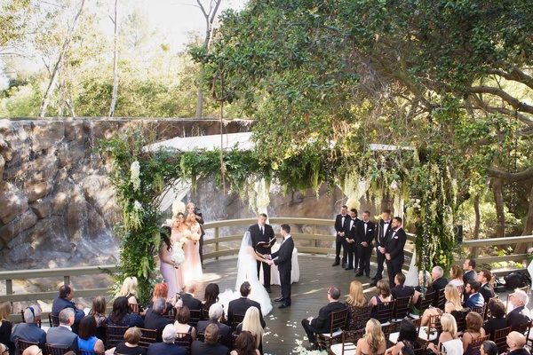 ceremony, oak room in calamigos ranch in malibu, ceremony in front of stone waterfall, large chuppah
