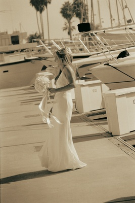 black and white bride with sailboats in background