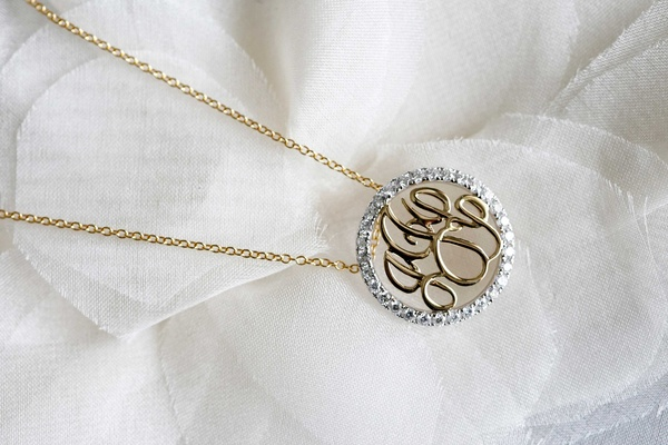 Gold necklace with monogram and diamond pendant