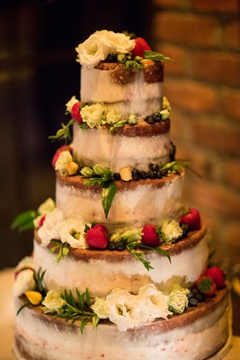 Wedding reception cake five layers semi naked wedding cake fresh flowers and fruit