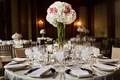 Wedding reception centerpiece with white hydrangeas and red peonies