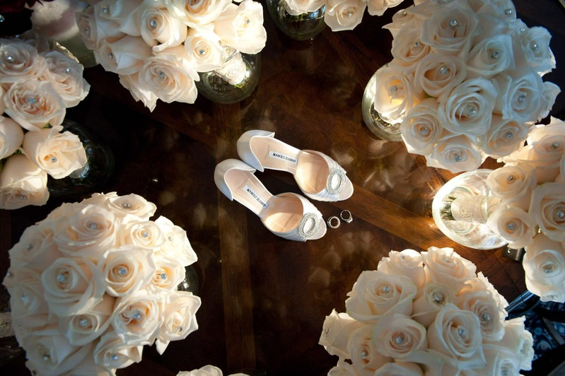 Bridesmaids' bouquets of white roses dotted with pearls