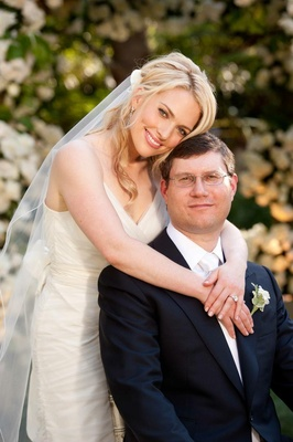 Blonde bride with groom in glasses at ceremony