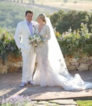 bride in marchesa wedding dress long sleeves v neck mermaid, groom in white tux and lavender shirt
