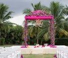 indian wedding magenta mandap with florals and chandelier