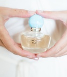 "wedding perfume bottle with blue cap that says ""something blue"" oscar de la renta fragrance"