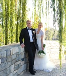 Bride and groom on stone bridge in wedding attire