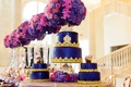 three wedding cakes with deep blue fondant and gold border