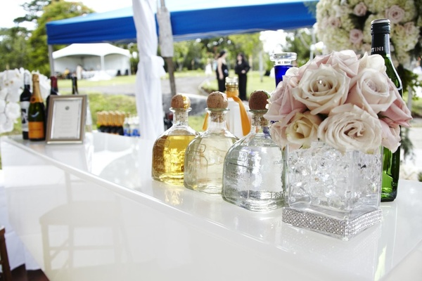 A variety of alcohol is served at a wedding's cocktail hour in Hawaii