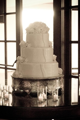 Three tier wedding cake on silver cake stand