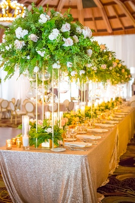 long table tall foliage arrangements shiny linen wedding hotel del coronado sequins ballroom