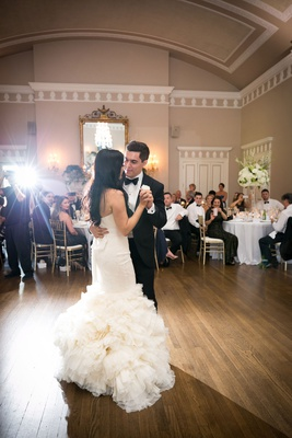 Bride in second wedding dress for reception vera wang white mermaid gown groom in tuxedo