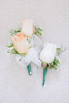 Groomsman's pastel orange rose boutonniere, groom's white rose boutonniere