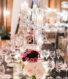 Rectangle reception table with low rose and purple centerpieces tall clear candleholders acrylic