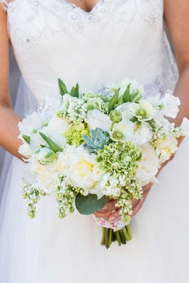 White wedding bouquet with green foliage and succulents