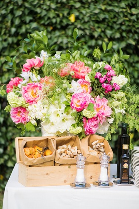 outdoor wedding cocktail hour appetizer buffet olive oil tasting pink peony white flower greenery
