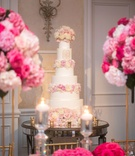 wedding reception ballroom white pink ivory cake fresh flowers monogram on mirror table