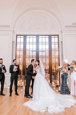 wedding ceremony bride groom kiss los angeles ballroom candles decor