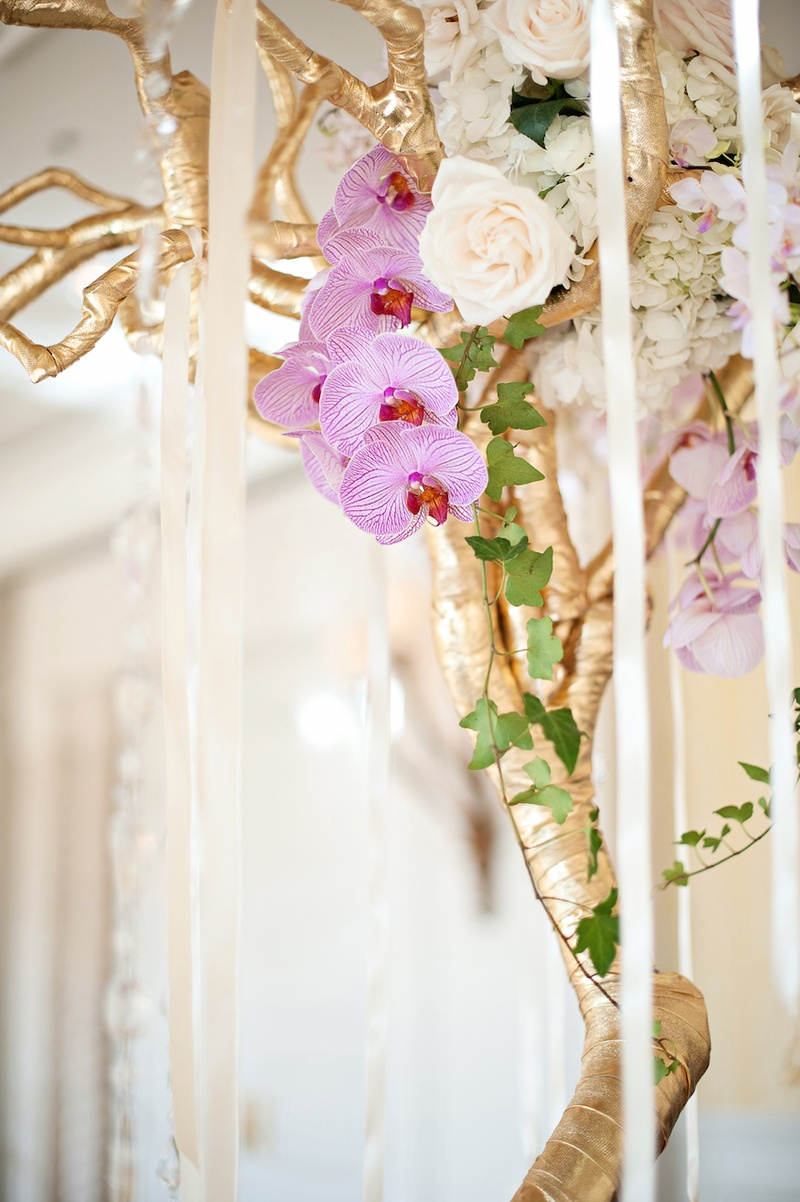 Gilt branches tied with crystals and romantic flowers