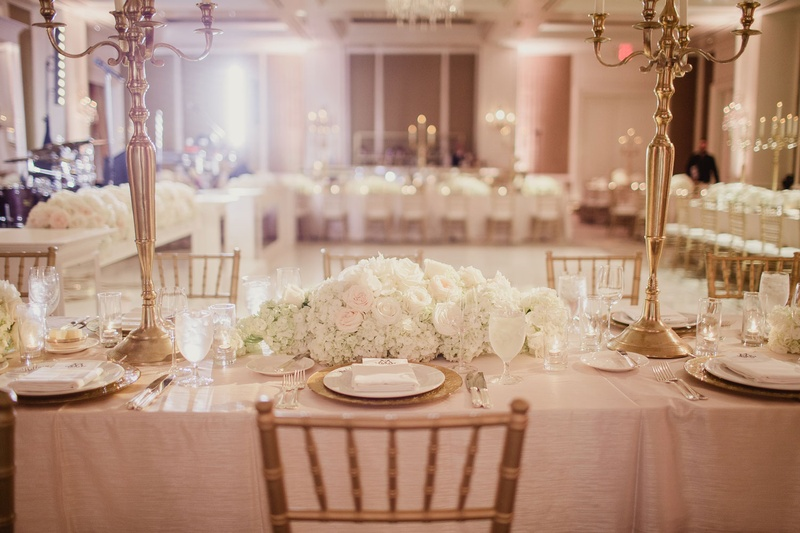 Reception dcor photos gold candelabra low centerpieces inside reception ballroom with rectangular table with linens ivory flowers gold candelabra wedding ideas junglespirit Choice Image