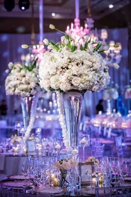Wedding reception centerpiece, light pink rose, white hydrangea, white tulip flowers purple lights