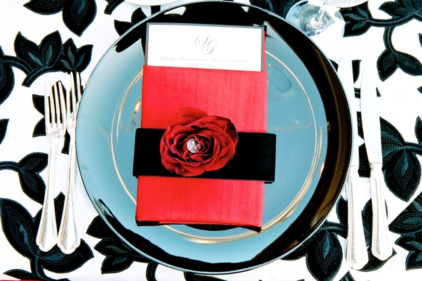 Wedding reception plate with black, red, white theme