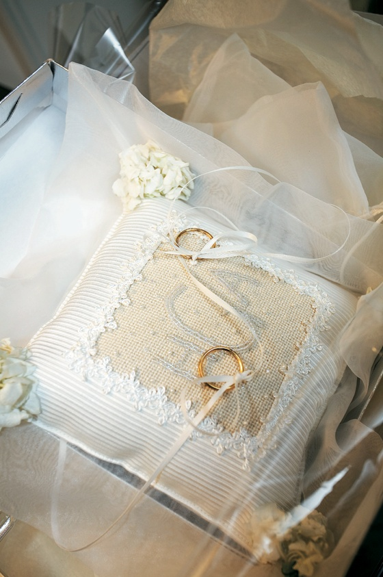 White and ivory cushion with rings on ribbon
