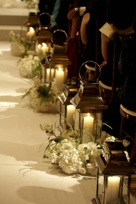 Wedding ceremony glass lantern and candle aisle embellishment