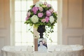 Seating cards and guestbook around pink floral arrangement