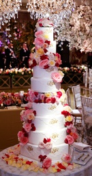 Eight layer cake with fresh flowers and lace design