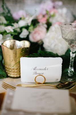 White place card escort card with calligraphy name and natural torn edge gold flatware and candle