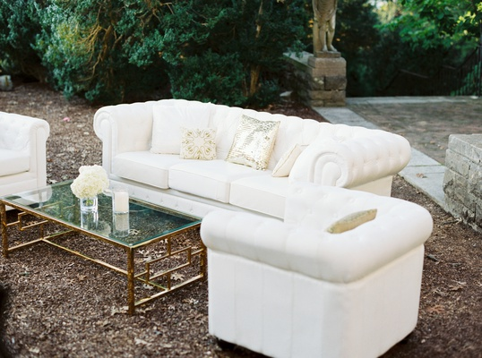 outdoor lounge area at wedding cocktail hour, sequin pillow, cream couches