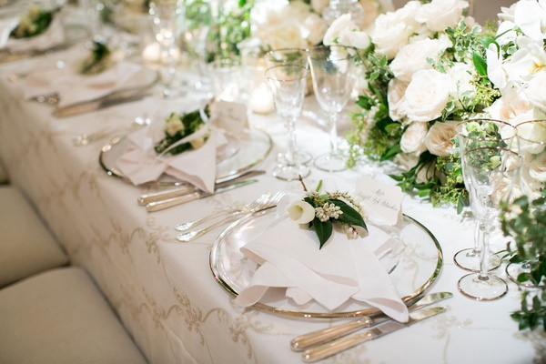wedding reception place setting white linens silver charger plate fresh flower calla lily leaves