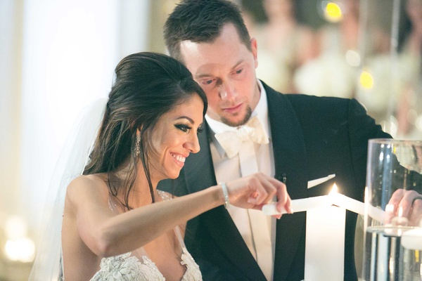 Wedding ceremony Chris Johnson and Tia Garavuso lighting unity candle at biltmore ballrooms ceremony