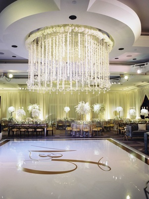 White dance floor with gold monogram and border crystal orb, flower garland ceiling treatment design