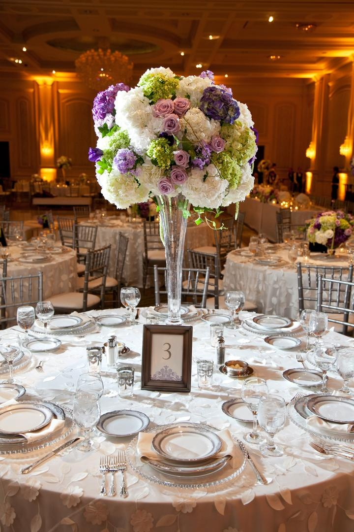 Reception décor photos tall purple white green floral