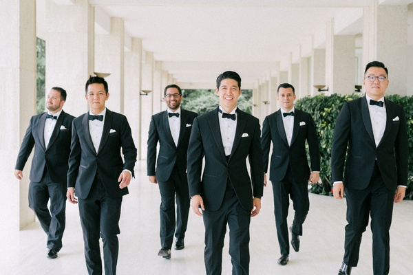 Wedding in the South of France groomsmen in tuxedos with bow ties and pocket squares