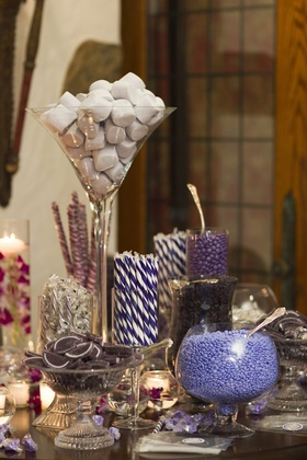 Wedding reception with a candy bar offering different sweets in purple colors