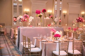 wedding reception ballroom pink centerpiece pink banquette bench gold chiavari chairs