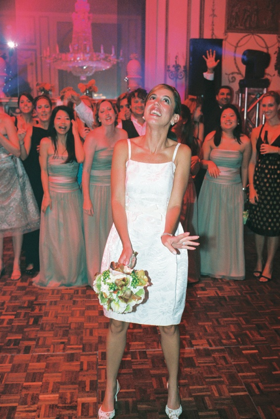 Bride in Bill Blass tulip dress at reception